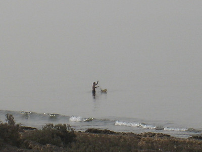A fisherman on the coast road heading to Sur.