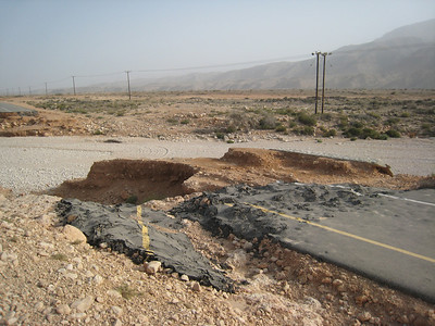 More cyclone damage on the coast road.  The road crossed over a wadi and has just been sliced away by the force of the water.