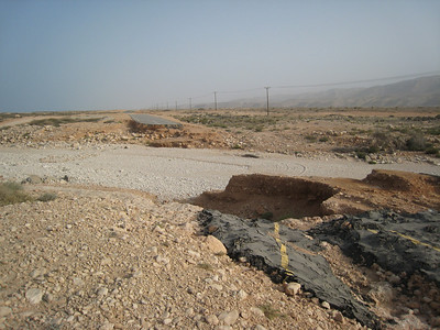 Cyclone damage to the coast road to Sur, Oman.  Some of the roads were brand new and were destroyed even before they were open.
