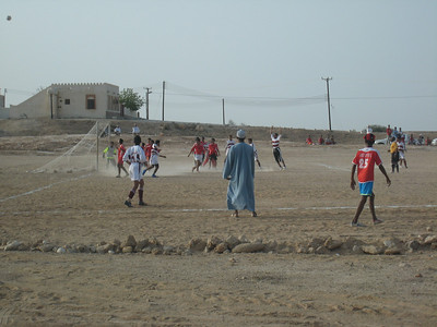 A local soccer game in progress in a small village between Fans and Taab on the Muscat-Sur road.  The man in the blue dishdash is the coach of one of the teams, though I'm not sure which team as he seemed to yell instructions at *all* the players.