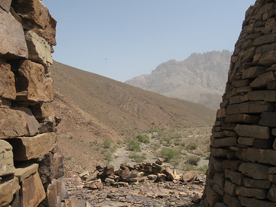 Looking between two of the tombs towards Jebel Misht