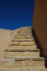 Stairs from the roof leading up to the battlements at Rustaq Castle.