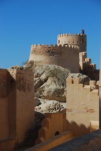"Nakhal Fort in the Al Batinah region of Oman.  Allen doing his best ""Titanic"" impression on the tower."