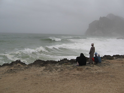 Local family watching the waves