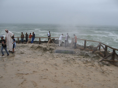 A grid has been put over the blowhole and the locals...and others...stand on it and the water powers up through it.