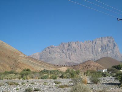 The tombs at Al Ayn with Jebel Misch looming in the background.
