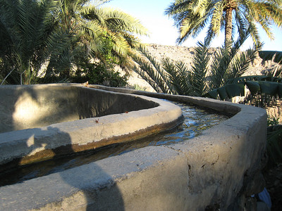 The falaj (chanel) system which carries water around the village and to the hillside fields where crops are grown.  While it is now lined with concrete the system has been working for nearly a thousand years.