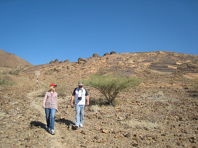 Carolynn and Stan walking down from the tombs at Al Ayn.