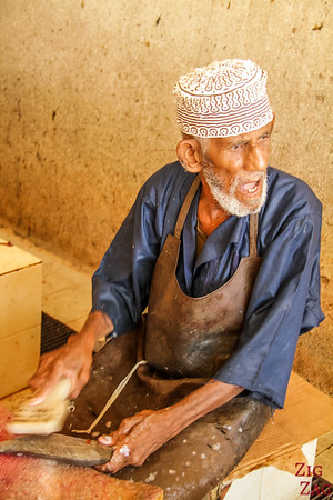 preparing the fish at the Muttrah Fish market, Muscat 2