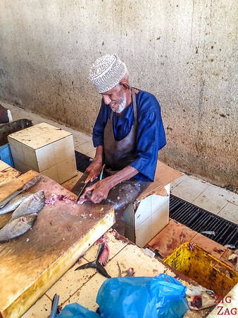 preparing the fish at the Muttrah Fish market, Muscat