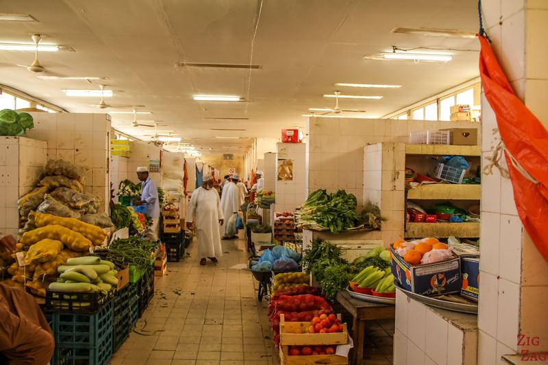 Oman people - men at souq