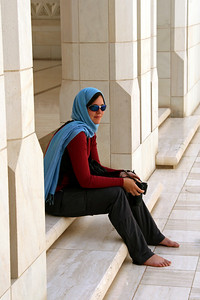 Relaxing in the shadowy parts around the mosque