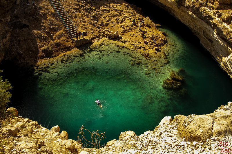 Swimming in the turquoise water of the Oman Dabab Sinkhole 2