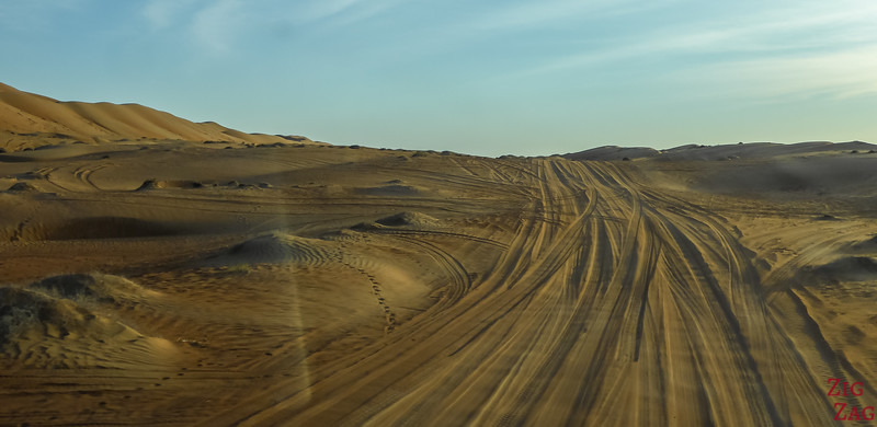 Driving through the dunes to camping spot Oman