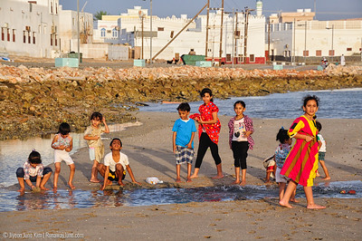 Playing in the Gulf of Oman