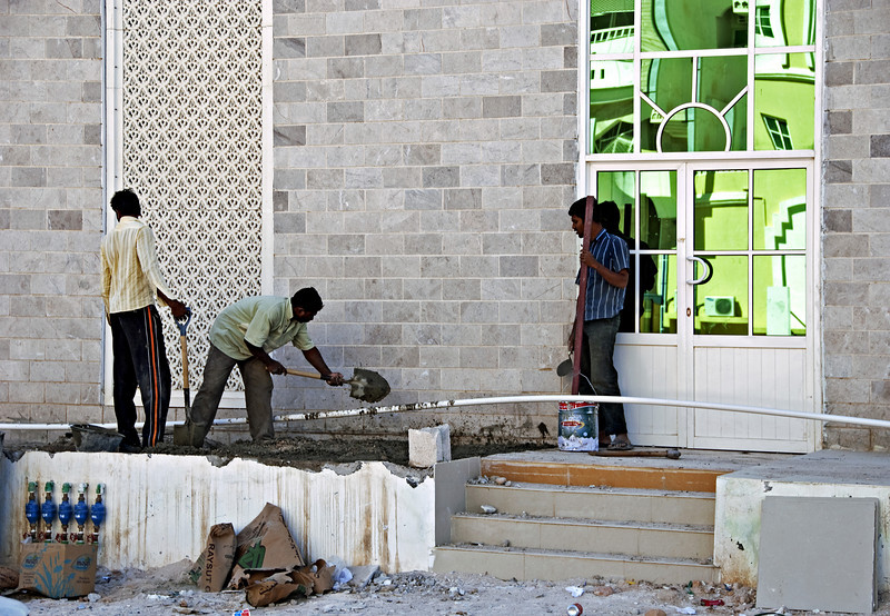 Construction workers and abstract reflections, Salalah