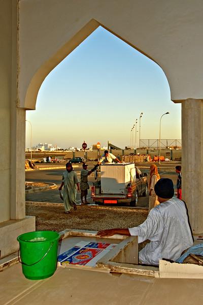 Unloading fish, early morning, fish souk, Sur.
