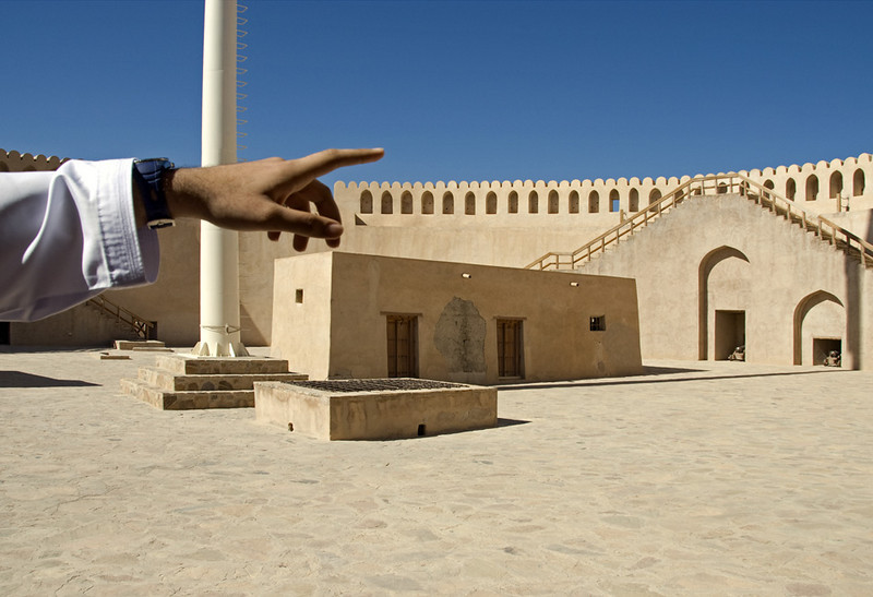 High atop Nizwa Fort, Ahmed (our other family guide for the day) points out a spot of dust on my camera sensor.
