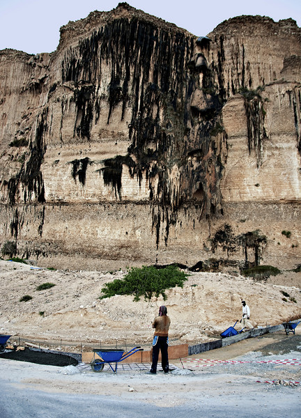 Cliff with stalactites from eons of water seepage, near Hasik.