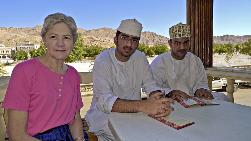 Carolyn, Ahmed, and Ali at a traditional Omani Restaurant in Nizwa (the table and chairs were in deference to Carolyn and me).