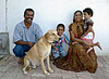 Hari, the farm manager, with his family and dog.