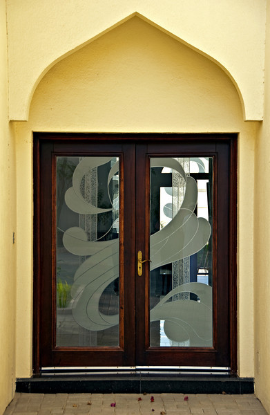 Doorway with etched glass design, private home, Muscat