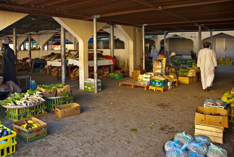 Merchants in the vegetable souk, Sur.