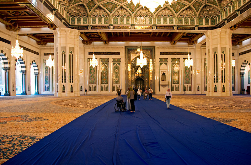 The main hall of the Grand Mosque, in Muscat. On the floor is the largest one-piece Persian carpet in the world (the blue cloth is rolled out during visiting hours).