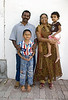 Hari, the farm manager, his wife, and their two children.