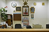 Reception desk of our hotel in Sur. Notice the portrait of the Sultan on the wall.