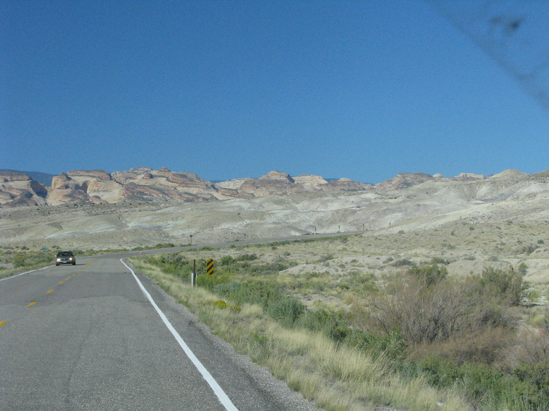 Hwy24 runs through some bare brown hills.