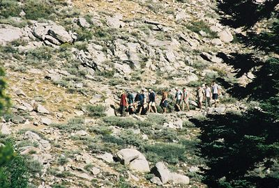 7/9/00 Hikers descending Kearsarge Pass trail with (injured?) hiker in tow. Onion Valley.