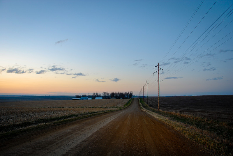 """<span id=""""title"""">Dirt Road Dusk</span> <em>NW of Orange City</em> After the sun set, we drove around on some of the unpaved roads outside of the city. We saw a pheasant, a fire and two dead pigs. Weird."""