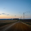 "<span id=""title"">Dirt Road Dusk</span> <em>NW of Orange City</em> After the sun set, we drove around on some of the unpaved roads outside of the city. We saw a pheasant, a fire and two dead pigs. Weird."