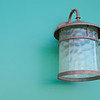 """<span id=""""title"""">Lamp</span> On the main drag of downtown, I found this sharp-looking lamp on a nice teal wall. I took a photo."""