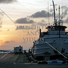 Sunset view of the boat docked at the port of Oranjestad in the Caribbean island of Aruba.
