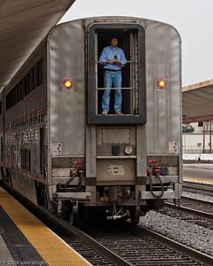 A hostler guiding the Coast Stalight into Union Station