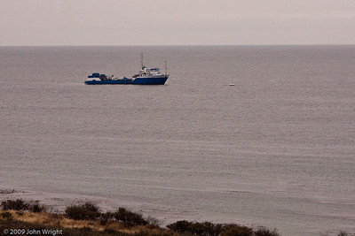Some type of research or fishing vessel off the coast
