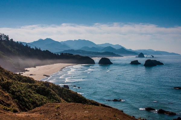 View from Ecola State Park looking south toward Cannon Beach.  You can see Haystack Rock in the distance (middle-right side of the scene).  Some morning fog still hovers along the beaches.