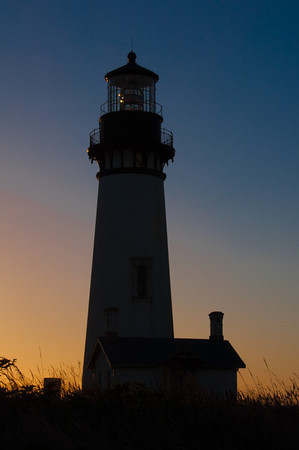 Yaquina Head lighthouse at sunset.