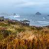 From the top of Coquille Point in Bandon, Oregon, you get a vista of Bandon Beach in the early morning fog and the sturdy, long staircase leading down to the beach.