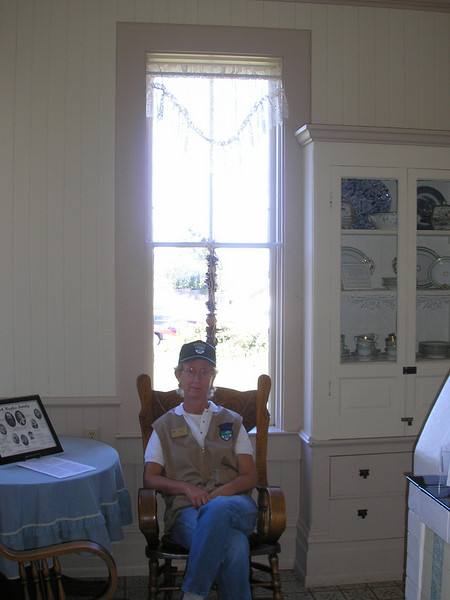 Here is Jeanie sitting in the kitchen at Hughes House.  They let us sit in these rockers when things got slow.