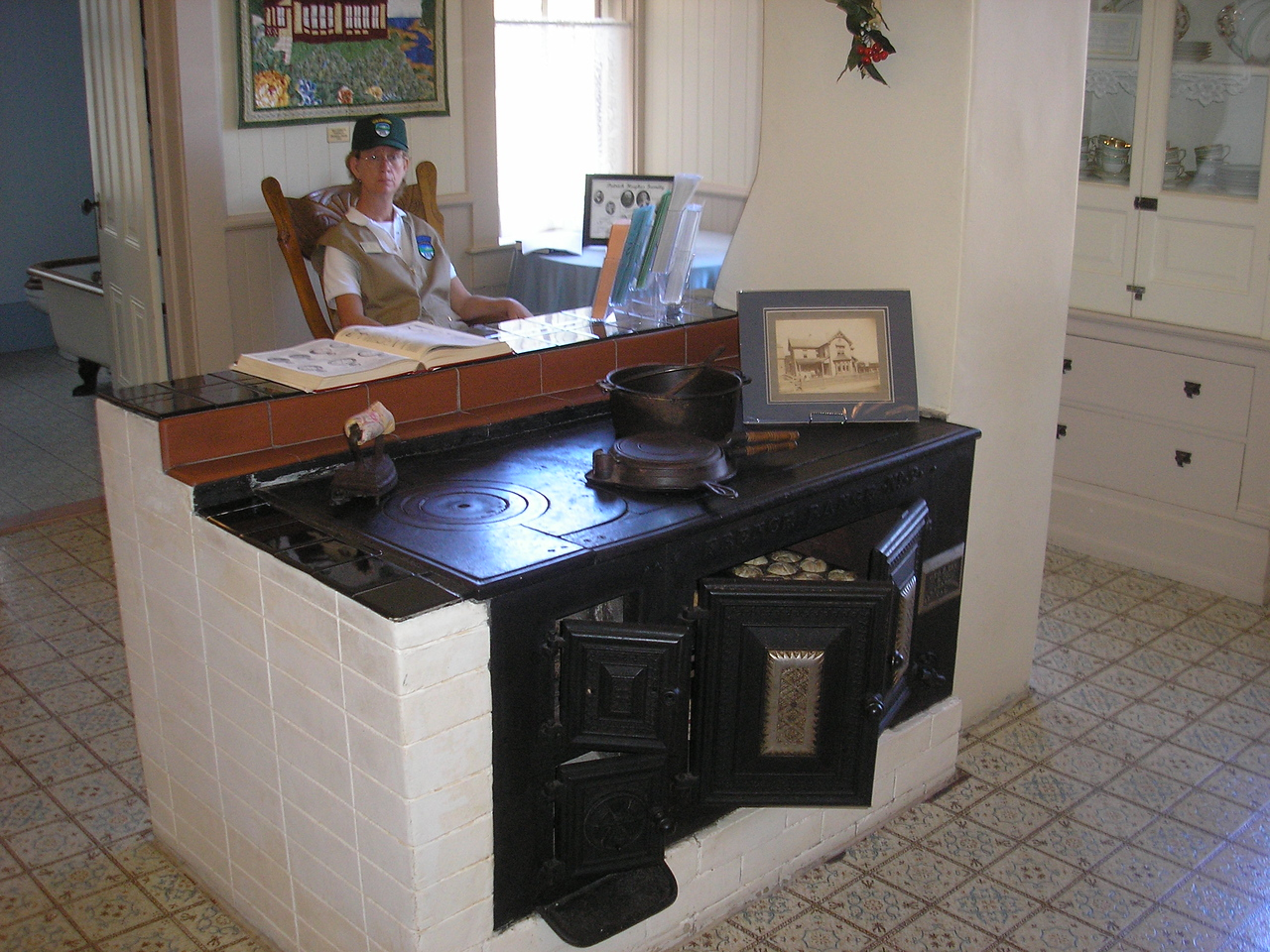 The center piece of the kitchen in the Hughes House is the wood burning cast iron stove.  It was used to heat the house, cook the meals and had coils bilt in it to heat water for the indoor plumbing fixtures.