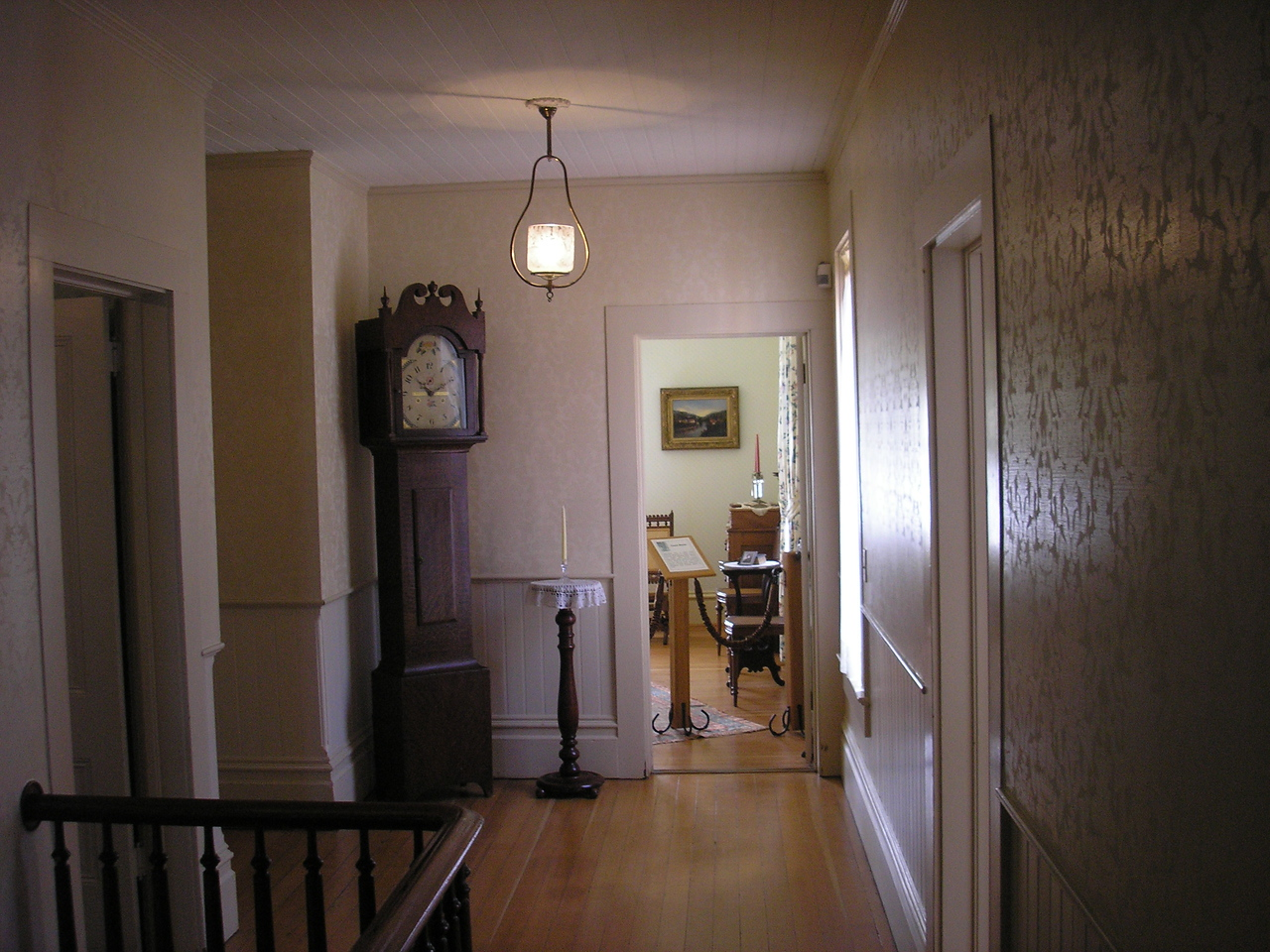 Upstairs hallway, looking into the guest room of the Hughes House.
