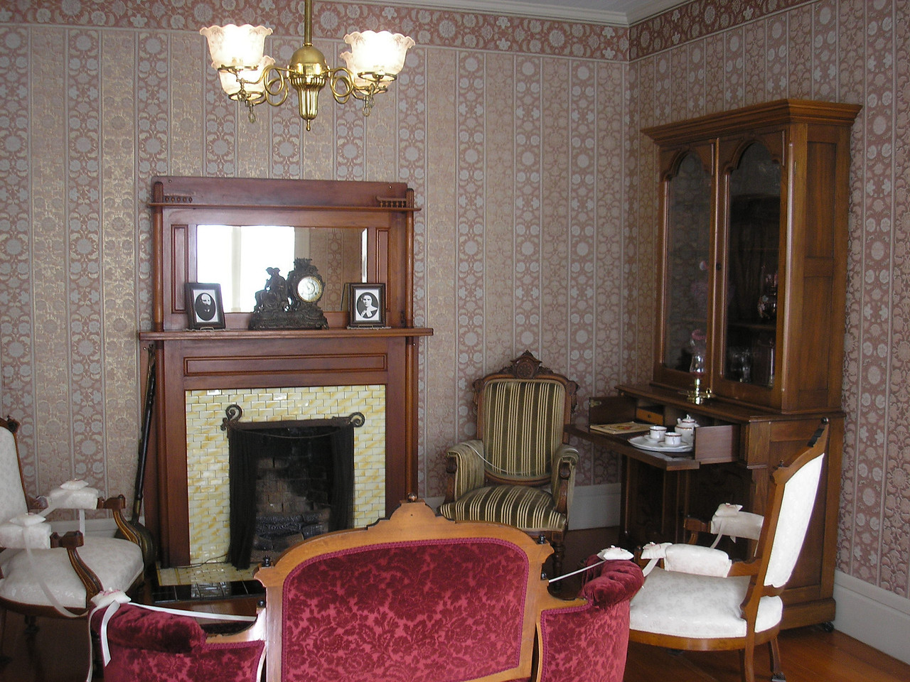 This is the Formal Parlor, it had a coal burning fireplace in the Hughes House.