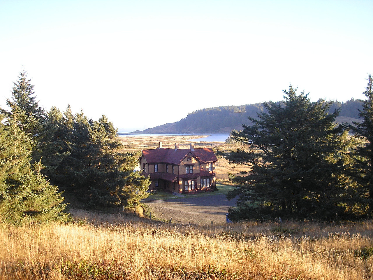 Here is a photo of The Hughes House with the Pacific Ocean in the background.