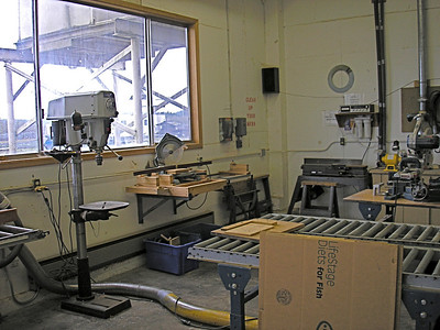 Drill press, shaper, and a dust collection system.