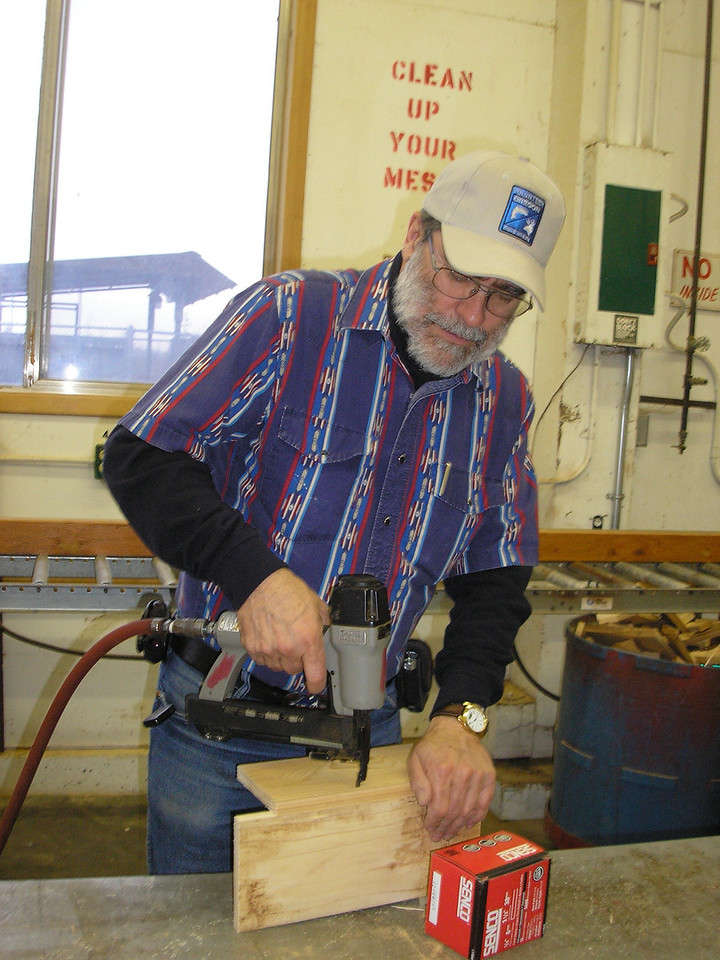 Here John is putting together the side and back of a nesting box.
