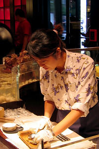 Lady digging out a pearl from an oyster.  Cly bought one for Darcie in the Japanese pavillion at EPCOT.