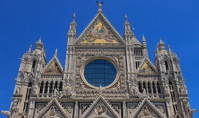 Siena Cathedral opened in 1263 and shares the theme of colorful mosaics with the newer Orvieto Cathedral.